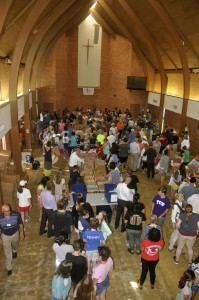 Members of Grace Northridge Church assemble summer snack packs in their new church building.