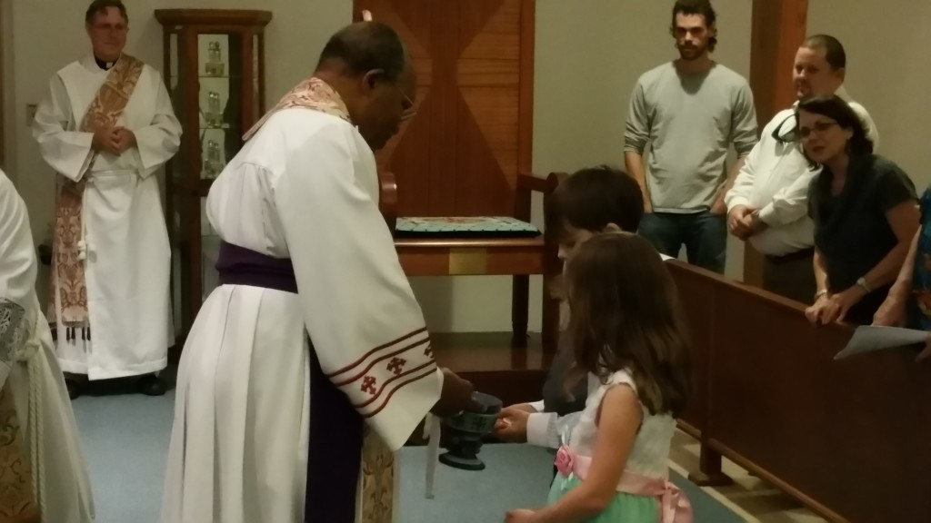 Archbishop Kolini gives First Holy Communion to Emma and Logan Waltrip of Tampa.