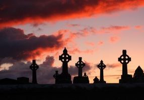 Celtic Crosses graveyard sunset - Shutterstock